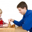 man and child play chess — Stock Photo