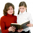 Woman and girl reads a book — Stock Photo