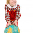 Little girl and terrestrial globe — Stock Photo #1019553