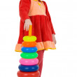Little girl and plastic toy pyramid — Stock Photo