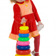 Little girl and toy plastic pyramid — Stock Photo #1019597