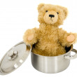 Royalty-Free Stock Photo: Toy brown bear in saucepan