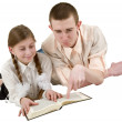 Young man and girl reading book — Stock Photo