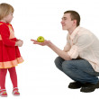 Young man, apple and little girl — Stock Photo