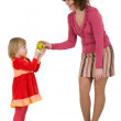 Woman, little girl and apple — Stock Photo