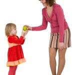 Woman, little girl and apple — Stockfoto