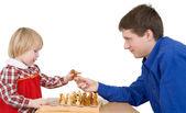 Man give child chess-man — Stock Photo