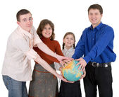 Family and terrestrial globe — Stock fotografie