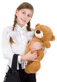 Schoolgirl with bear — Stock Photo