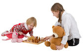 Girls playing chess — Stock Photo