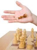 Hand and chess-man — Stock Photo