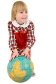 Little girl and terrestrial globe — Stock fotografie