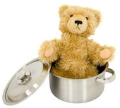 Toy brown bear in saucepan — Stock Photo