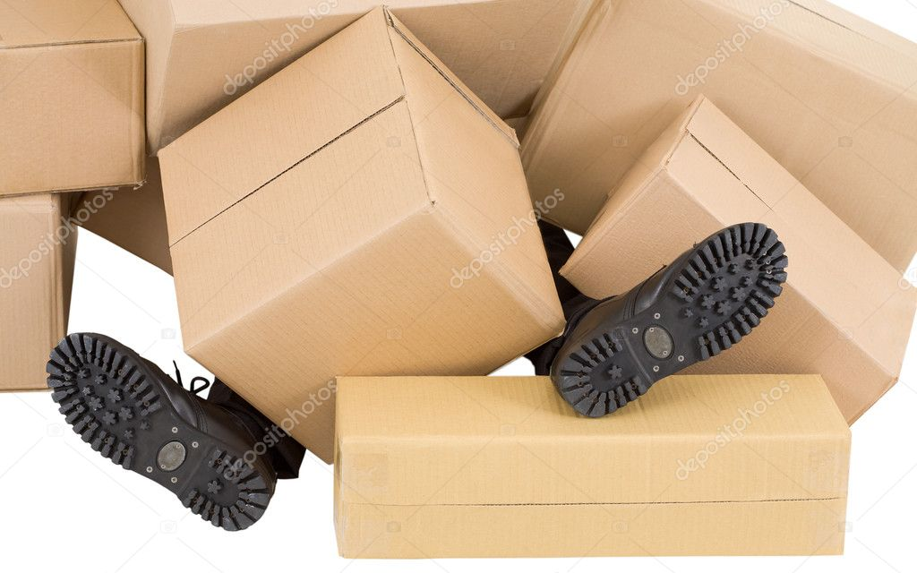 Male feet sticking out from under heaps of boxes — Stock Photo #1014833