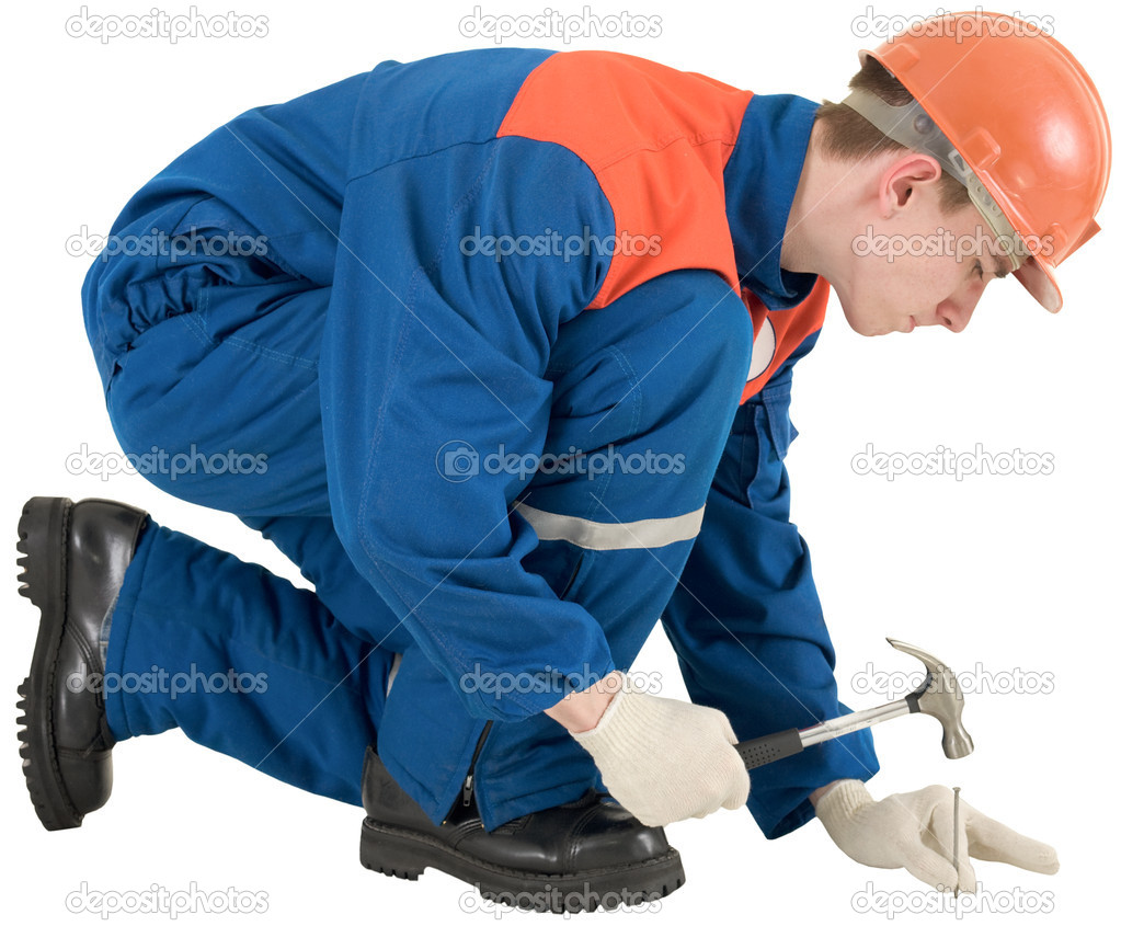 Man in worker overalls with hammer and nail — Stock Photo #1019718