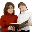 Woman and girl reading book — Stock Photo