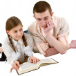 Girl and young man reading book in a rec — Stock Photo