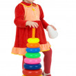 Little girl and toy pyramid — Stock Photo
