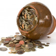 Clay pot with antique coins - Stock Photo