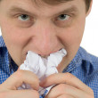 The man a chewing sheet of paper — Stock Photo