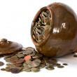 Clay pot with antique coins and lid - Stock Photo