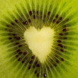 Fruit cut - kiwi forming a heart - Stock Photo