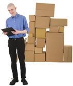 Messenger and pile of cardboard boxes — Stock Photo