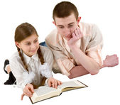 Girl and young man reading book in a rec — Stok fotoğraf