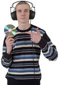 The young guy with ear-phones and a comp — Stock Photo