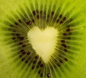 Fruit cut - kiwi forming a heart — Stock Photo