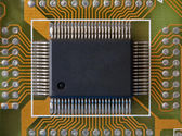Microphoto of an integrated microcircuit — Stock Photo