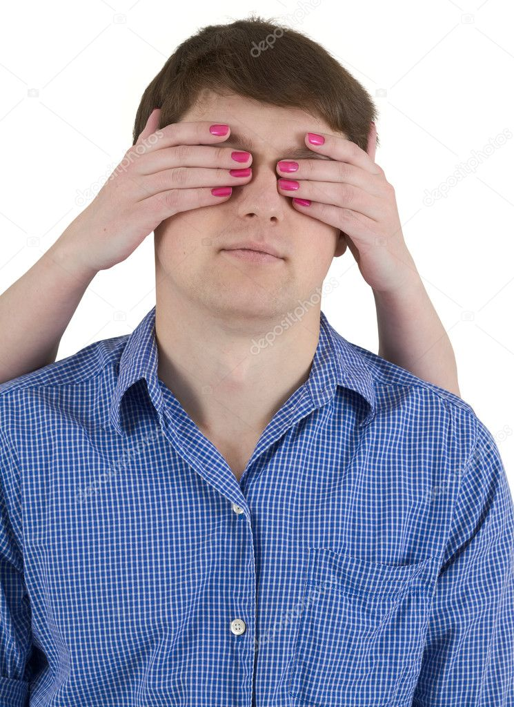 Man with covered eyes female hands on white — Stock Photo #1022149