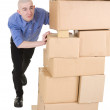 Man pushing heap from cardboard boxes — Stock Photo