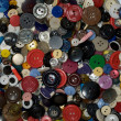 Multicolored plastic button background — ストック写真