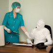 Patient similar to a mummy and the docto - Stock Photo