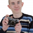 Young man with camera — Stock Photo