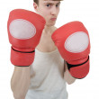 Thin boxer in red gloves — Stock Photo