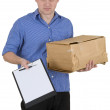 Man in baseball cap with cardboard box — Stock Photo