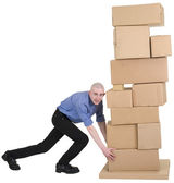 Man pushing pile from cardboard boxes — Stock Photo