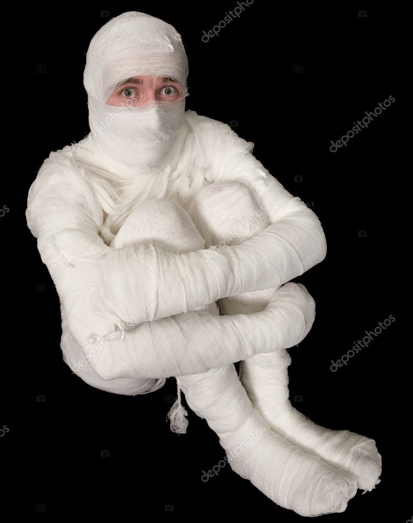 The funny Egyptian mummy emo sitting on a black background — Stock Photo #1047323
