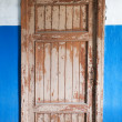 Stock Photo: Closed old decayed door