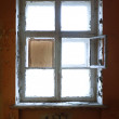 Stock Photo: Closed old decayed window