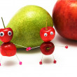 Two amusing little men a sweet cherry — Stock Photo