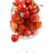 The glass filled by a sweet cherry — Stockfoto