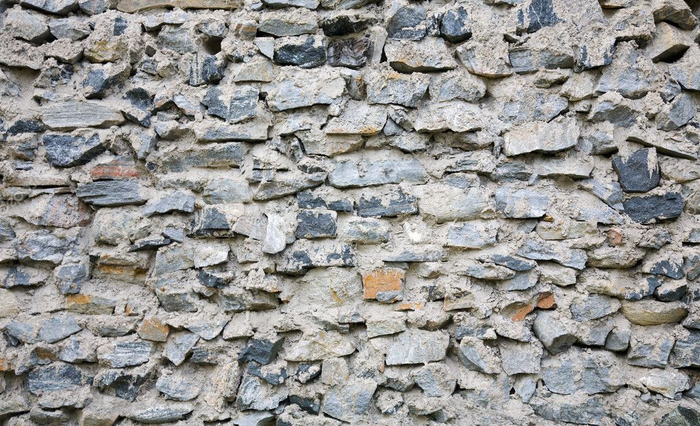 Ancient rough stone wall of a building — Stock Photo #1786076