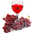 Glass of red wine and grapes clusters — Stock Photo