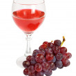 Stock Photo: Red wine and grapes cluster