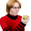 Royalty-Free Stock Photo: The girl eats an apple