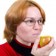 The girl eats an green apple — Stock Photo