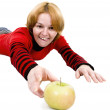 Woman giving a hand to apple — Stock Photo